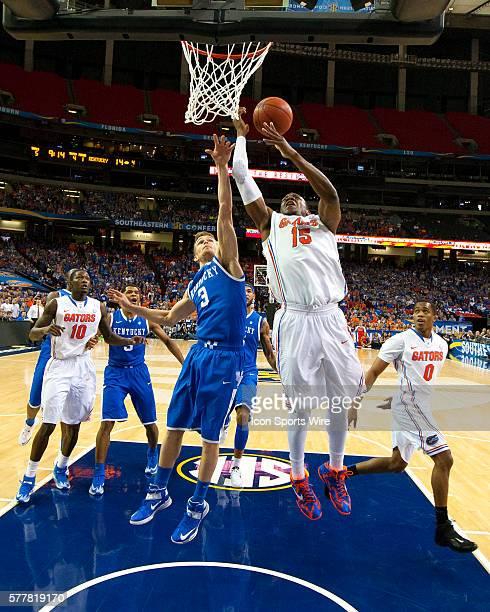 Florida Gators forward Will Yeguete goes up for the shot over Kentucky Wildcats guard Jarrod Polson in the Florida Gators 6160 victory over the...