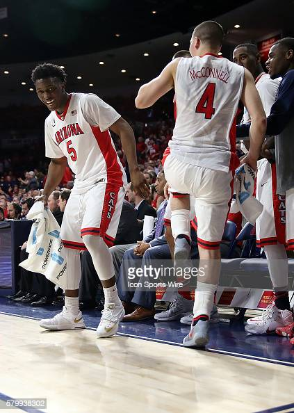 Arizona Wildcats forward Stanley Johnson and guard TJ McConnell celebrate a basket during the second half of the Pac12 college basketball game...