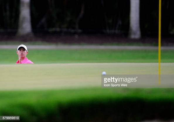 Rory McIlroy of Northern Ireland watches his chip shot during the third round of the World Golf ChampionshipsCadillac Championship on the TPC Blue...