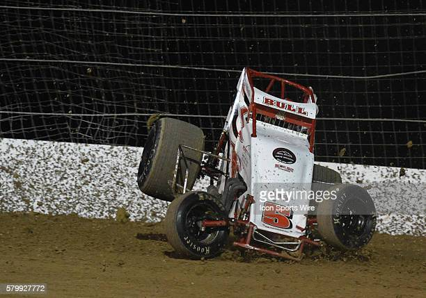 Ty Mihocko crashes and rolls his sprint car at the beginning of turn twoduring a heat race for the USAC West Coast Sprint cars at The Dirt Track at...