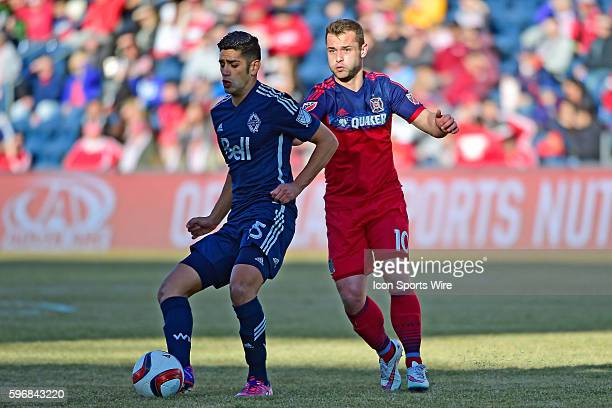 Vancouver FC midfielder Matias Laba and Chicago Fire midfielder Shaun Maloney battle while playing in a MLS soccer match between the Chicago Fire and...