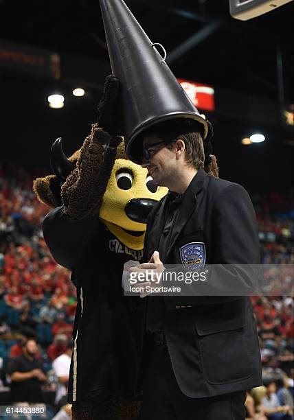 Colorado mascot Chip puts a megaphone on the head of an MGM security guard during the men's Pac12 Basketball Tournament game between the Colorado...