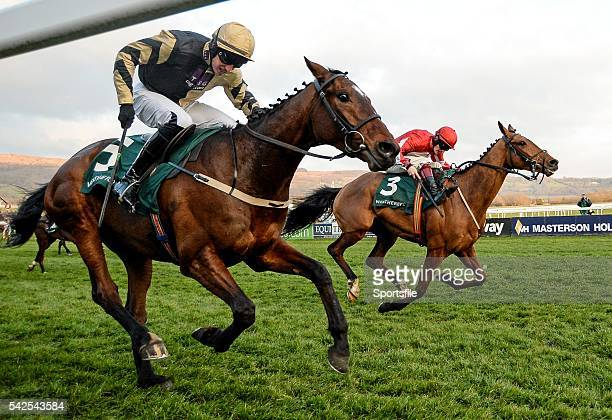 16 March 2016 Eventual winner Ballyandy right with Sam TwistonDavies up races alongside Battleford with Mikey Fogarty up on their way to winning the...
