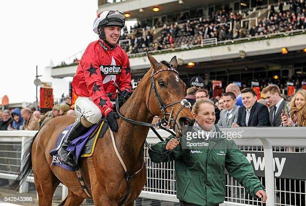 16 March 2016 Jockey Ryan Hatch and stable hand Fay Shelton celebrate as they return to the winners enclosure after winning the RSA Steeple Chase...