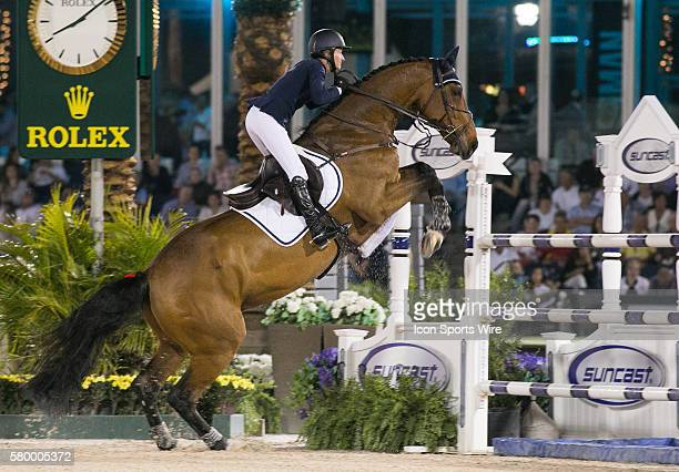 Molly AsheCawley rides during the Douglas Elliman CSI 5 Grand Prix during the Winter Equestrian Festival at The Palm Beach International Equestrian...