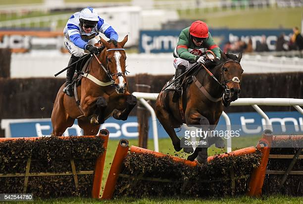 18 March 2016 Unowhatimeanharry right with Noel Fehily up jumps the last alongside Fagan with Davey Russell up who finished second on their way to...
