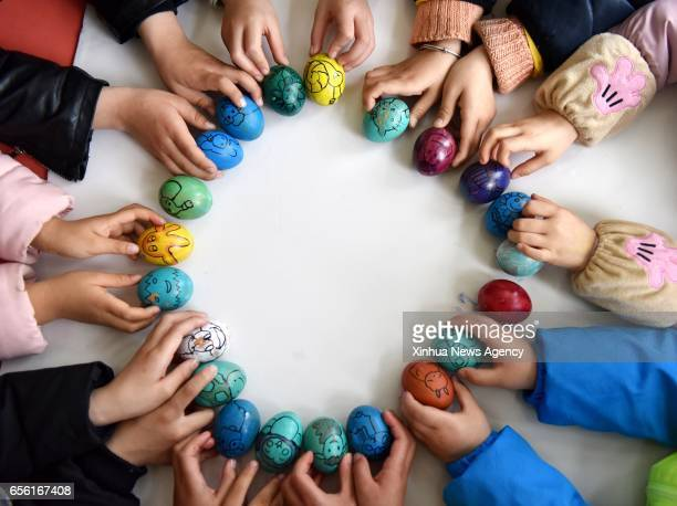 CHAOHU March 21 2017 Children prepare for a game to stand eggs on end in a kindergarten in Chaohu City east China's Anhui Province March 20 to greet...