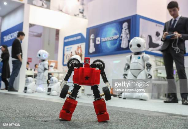 HANOVER March 21 2017 Photo taken on March 20 2017 shows a transformable robot performing at the booth of Tanscorp during the CeBIT 2017 in Hanover...