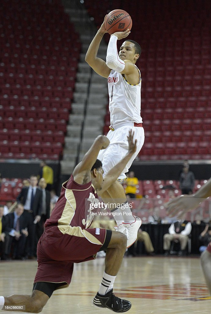 Maryland guard Seth Allen (4) shoots as Denver guard Cam Griffin (30) stumbles as he attempts to cover the play in the second round of the NIT on March 21, 2013 in College Park, MD