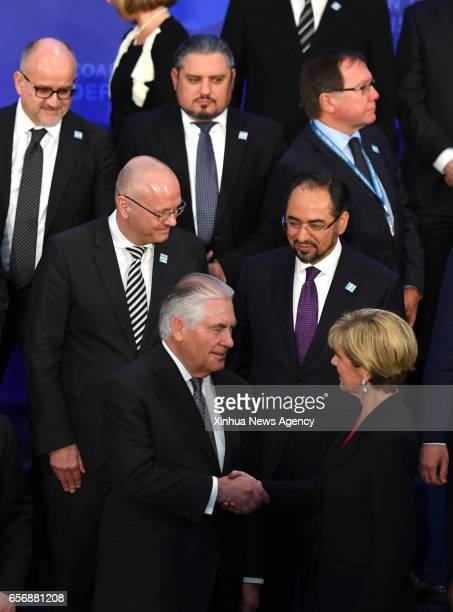 WASHINGTON March 22 2017 US Secretary of State Rex Tillerson shakes hands with Australian Foreign Minister Julie Bishop as delegates to the Meeting...