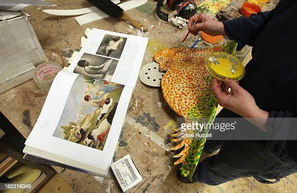 March 24 2009 Kathryn Kerr paints a prop for 'Sunday in the Park with George' a musical based on the French impressionist painter Georges Seurat as...
