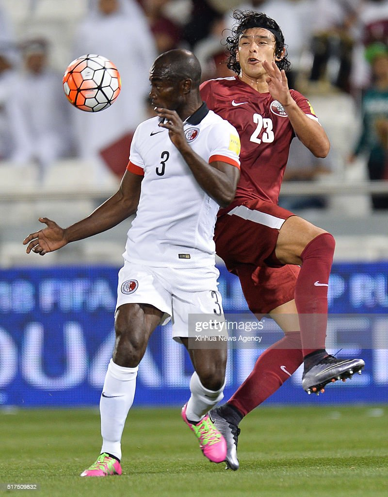 DOHA March 25 2016 Baise Festus left of China's Hong Kong vies with Sebastian Soria of Qatar during their 2018 FIFA World Cup qualifying match in...