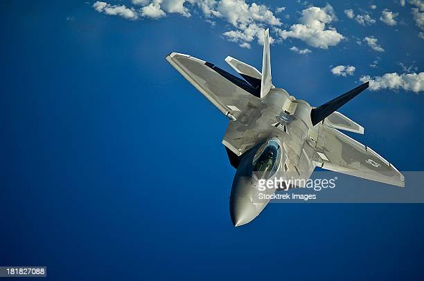 March 27, 2012 - An F-22 Raptor returns to a training mission after refueling over the Pacific Ocean near the Hawaiian Islands.