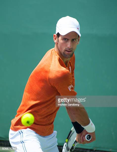 Novak Djokovic of Serbia warms up on the practice court before his third round match during the Miami Open Presented by Itau at Crandon Park Tennis...