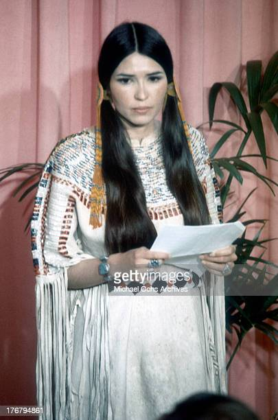 Sacheen Littlefeather holds a written statement from actor Marlon Brando refusing his Best Actor Oscar on stage at the Academy Awards on March 27...