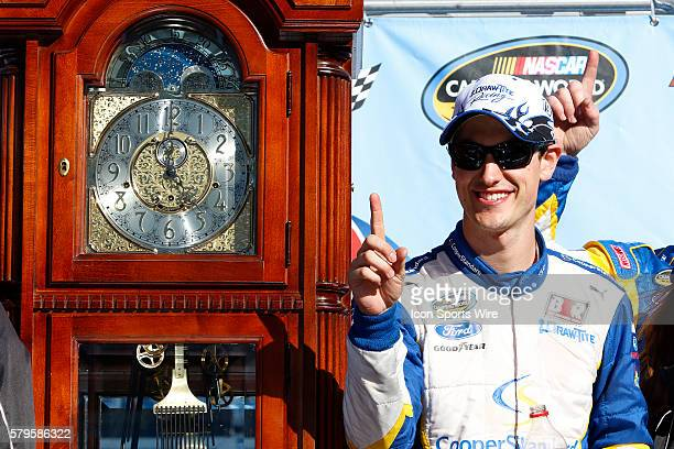 Joey Logano celebrates in Victory Circle after winning the Kroger 250 NASCAR Camping World Truck Series race at the Martinsville Speedway in Ridgeway...