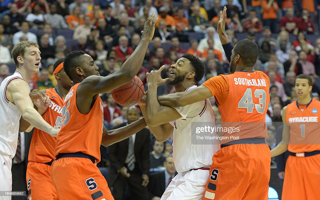 Indiana Hoosiers forward Christian Watford (2) loses control of the ball trying to get though the Syracuse defense under the basket during the second half in game 2 of the NCAA east regional on March 28, 2013 in Washington, DC
