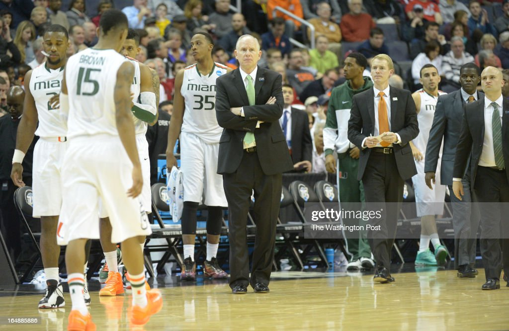 Miami head coach Jim Larranega and the Miami bench near the end of the game as the Hurricanes lose to Marquette 71-61 in game 1 of the NCAA east regional on March 28, 2013 in Washington, DC