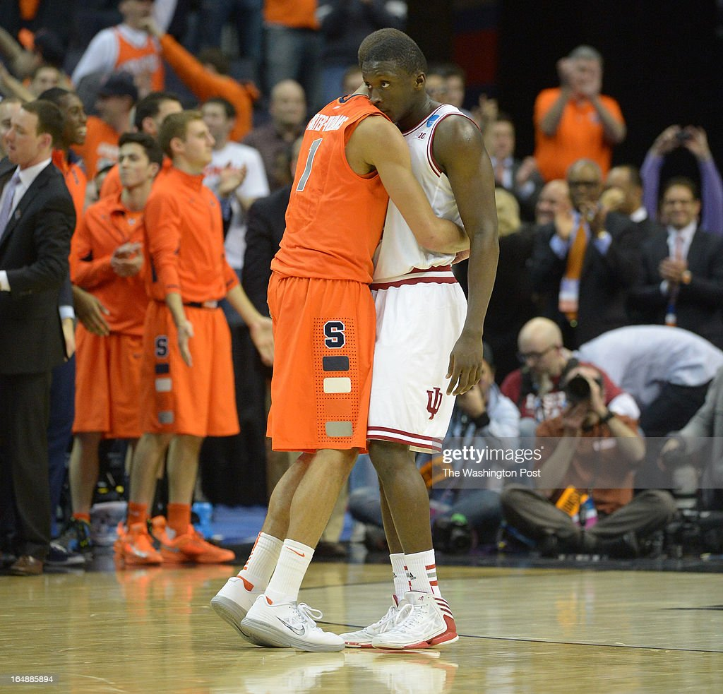 Syracuse guard Michael Carter-Williams (1) consoles Indiana Hoosiers guard Victor Oladipo (4) after Syracuse defeated Indiana 61-50 in game 2 of the NCAA east regional on March 28, 2013 in Washington, DC
