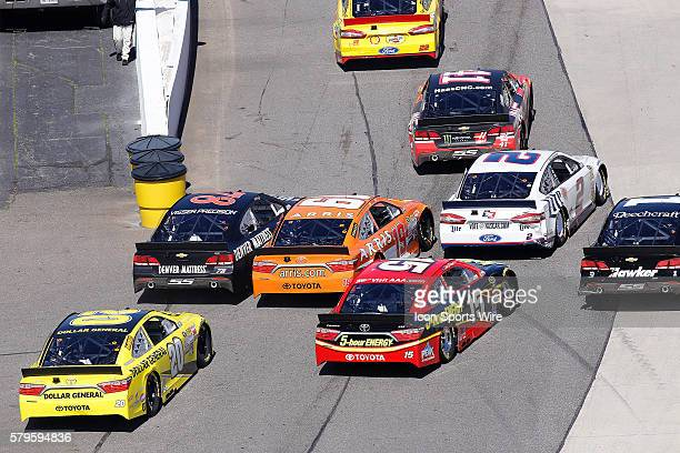Its tight quarters on pit road during the STP 500 NASCAR Sprint Cup Series race at the Martinsville Speedway in Ridgeway VA
