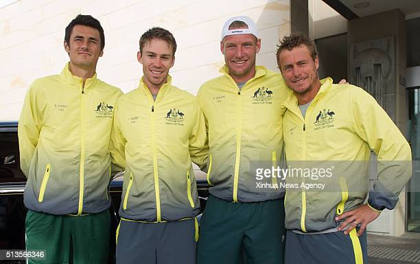 Bernard Tomic John Peers Sam Groth and Lleyton Hewitt left to right of Australia's Davis Cup team pose for photos as they arrive at the draw ceremony...