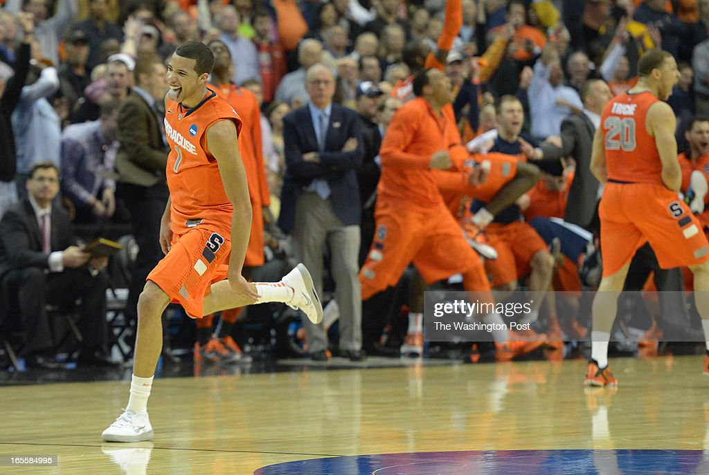 Syracuse guard Michael Carter-Williams (1) celebrates as he runs down court after draining a 3 pointer during the final minutes of their win over Marquette in the NCAA east region final on March 30, 2013 in Washington, DC