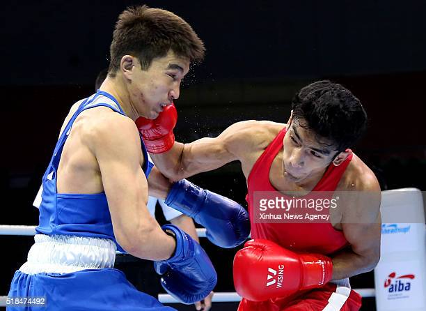 AN March 31 2016 Shiva Thapa right of India competes with Kairat Yeraliyev of Kazakhstan during their men's 64kg category of Asia/Oceania Zone boxing...