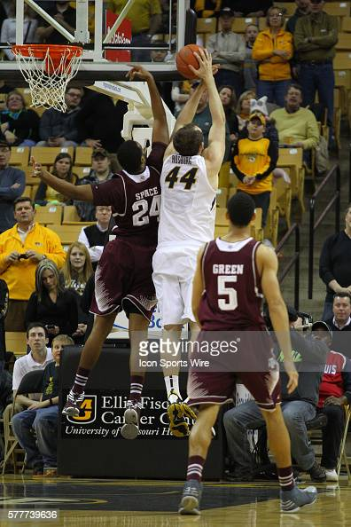 Missouri Tigers forward Ryan Rosburg puts the ball up over Texas AM Aggies forward Antwan Space during the NCAA men's basketball game between the...