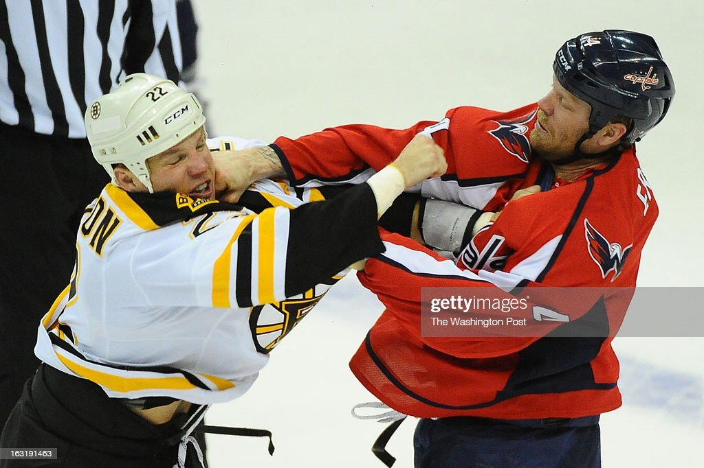 Washington Capitals defenseman John Erskine (4) connects during a fight against Boston Bruins right wing Shawn Thornton (22) on March 5, 2013 in Washington, DC
