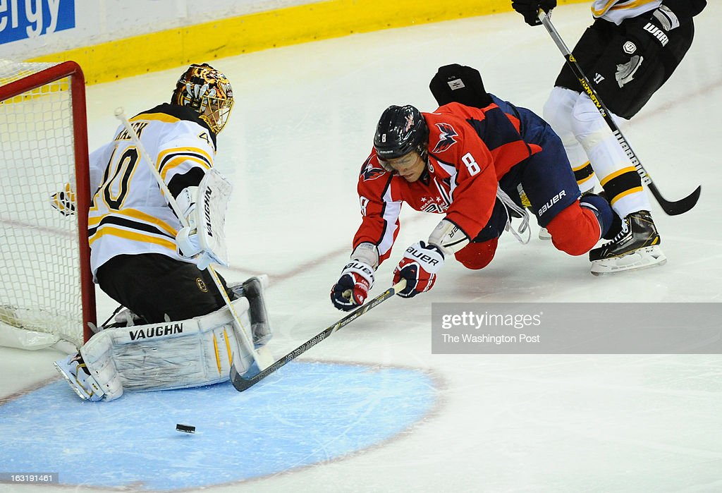 Washington Capitals left wing Alex Ovechkin (8) dives for the puck against Boston Bruins goalie Tuukka Rask (40) during 3rd period action on March 5, 2013 in Washington, DC