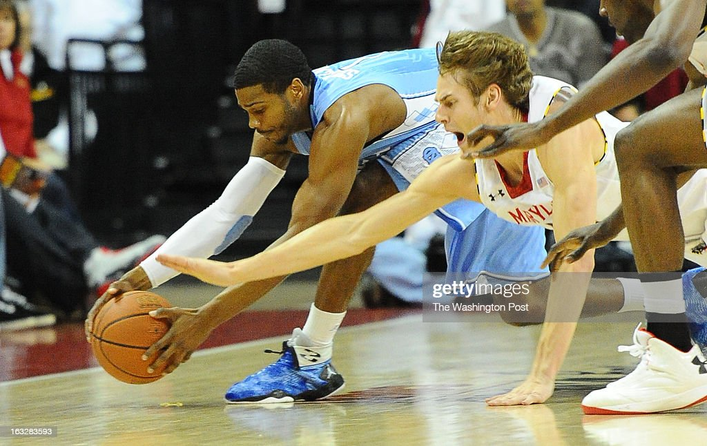North Carolina Tar Heels guard Dexter Strickland (1) and Maryland Terrapins forward Jake Layman (10) dive for a loose ball on March 6, 2013 in College Park, MD