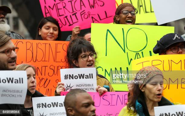 NEW YORK March 7 2017 Participants hold placards against the border wall building during a rally hosted by New York City Public Advocate Letitia...