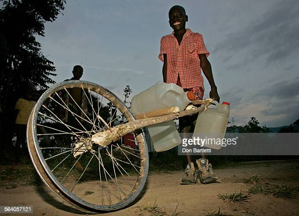 March 8 2004 Saint–Louis–du–Nord Haiti When a cooking oil bottle can't be sacrificed as a toy boat or a bike tire becomes an unaffordable luxury the...