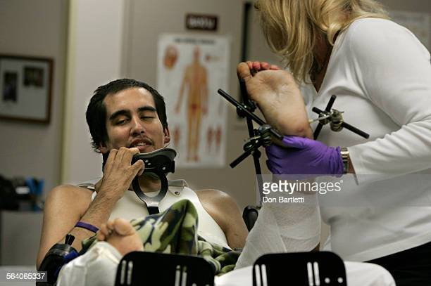 March 8 2007 La Jolla CA Physical therapist Charisse Caniff gently lifts Curtis Spivey's fractured leg for a range–of–motion session The 25 yr–old...