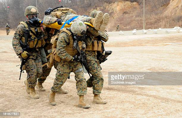 March 8, 2012 - U.S. Marines carry a fellow Marine on a stretcher while conducting tactical movement training at Camp Rodriguez, South Korea.