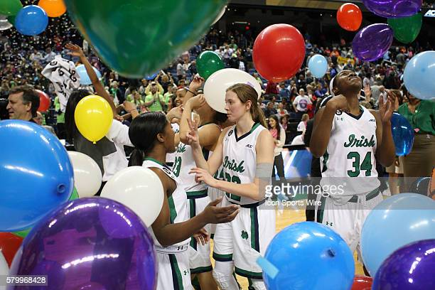 Notre Dame Fighting Irish guard Madison Cable and teammate Notre Dame forward Markisha Wright celebrate the ACC Women's Basketball Tournament...
