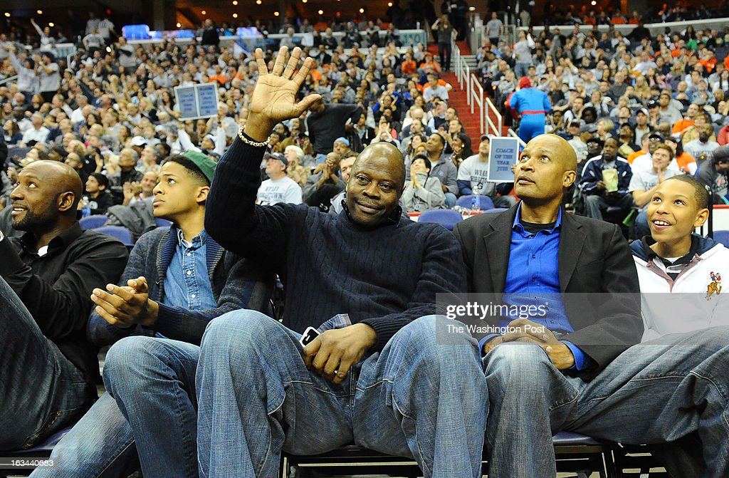 Former Georgetown great Patrick Ewing waves to the crowd during a timeout against Syracuse on March 9, 2013 in Washington, DC
