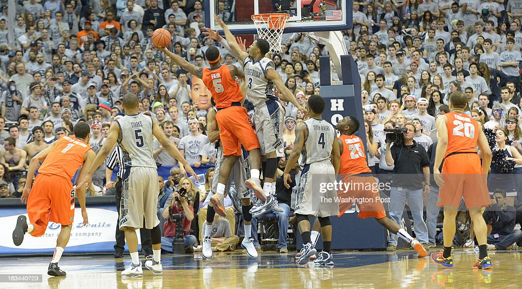 Georgetown center Mikael Hopkins (3) defends Syracuse forward C.J. Fair (5) as he drives the lane during 2nd half action on March 9, 2013 in Washington, DC
