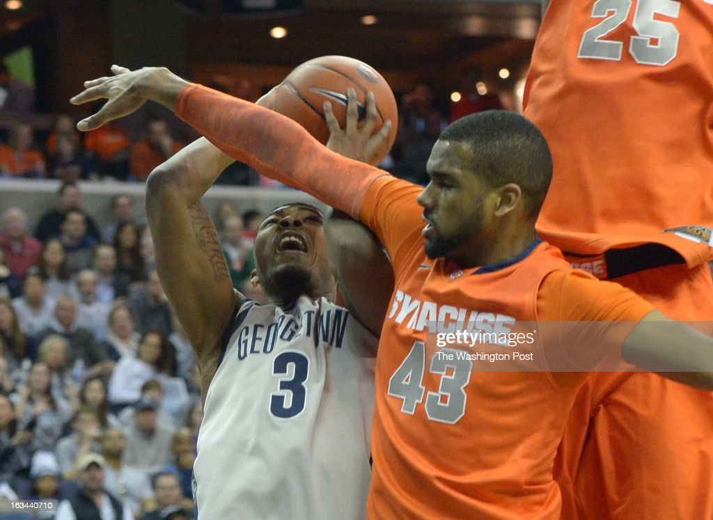 Georgetown center Mikael Hopkins (3) is fouled by Syracuse forward James Southerland (43) as he drives to the basket during 2nd half action on March 9, 2013 in Washington, DC