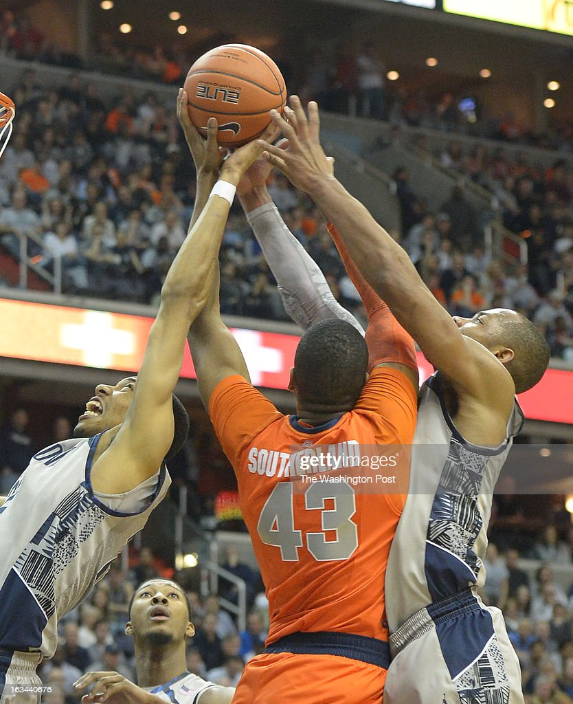 Georgetown forward Otto Porter Jr. (22) (L) and Jabril Trawick (55) battle for a rebound against Syracuse forward James Southerland (43) during 2nd half action on March 9, 2013 in Washington, DC