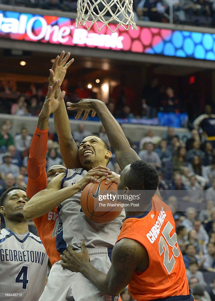 Georgetown forward Otto Porter Jr. (22) is fouled by Syracuse forward James Southerland (43) as he goes to the basket during 2nd half action on March 9, 2013 in Washington, DC