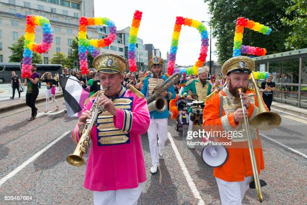 A march through Cardiff is led by a band during Pride Cymru's Big Weekend on August 26 2017 in Cardiff Wales Pride Cymru aims to eliminate...