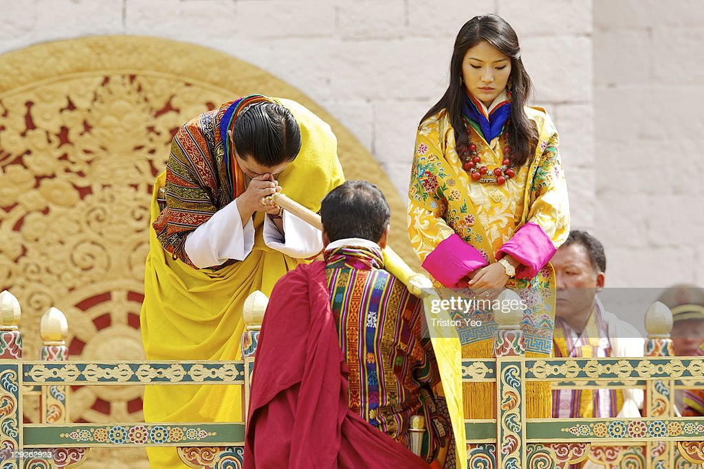Marchang is offered by Gyalpoi Zimpoen to His Majesty King <a gi-track='captionPersonalityLinkClicked' href=/galleries/search?phrase=Jigme+Khesar+Namgyel+Wangchuck&family=editorial&specificpeople=737466 ng-click='$event.stopPropagation()'>Jigme Khesar Namgyel Wangchuck</a> and Her Majesty Queen Ashi Jetsun Pema Wangchuck at the Chang Lime Thang stadium on October 15, 2011 in Thimphu, Bhutan. In this final day of wedding celebrations for the royal wedding, more than 50,000 people turned up at the stadium with about 500 performers to entertain the guests.