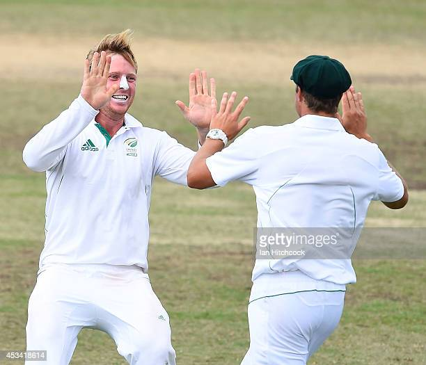 Marchant de Lange and Simon Harmer of South Africa 'A' celebrate the dismissal of Matthew Wade of Australia 'A' during the match between Australia...