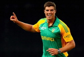 Marchant de Lange of South Africa celebrates his wicket of Nathan McCullum of New Zealand during the One Day International match between New Zealand...