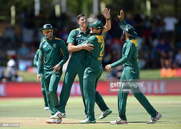 Marchant de Lange of South Africa celebrates with teammates after dismissing Alex Hales of England during the 1st Momentum ODI match between South...