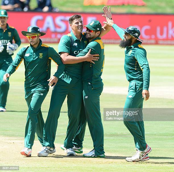 Marchant de Lange of the Proteas celebrates the wicket of Alex Hales of England with his team mates during the 1st Momentum ODI Series match between...