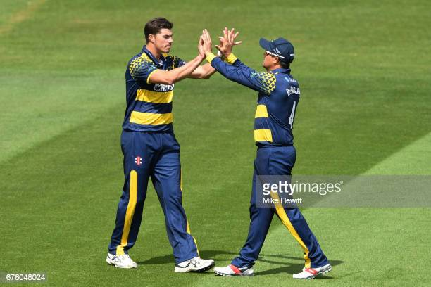 Marchant de Lange ofGlamorgan celebrates with Jacques Rudolph after they combined to dismiss Stiaan van Zyl of Sussex during the Royal London OneDay...