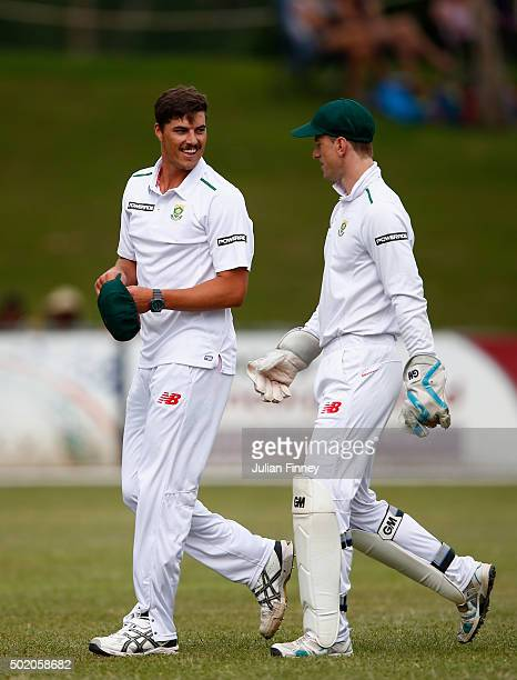 Marchant de Lange speaks with Dane Vilas of South Africa during day one of the tour match between South Africa A and England at City Oval on December...