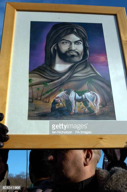 A marcher holds a portrait of the muslim martyr Imam Hussein during a march across west London Thursday February 9 the 10th day of Muharram which...